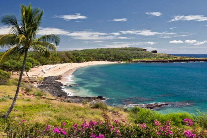 Take a Hawaii trip and enjoy the crystal blue Pacific Ocean and sandy beaches.
