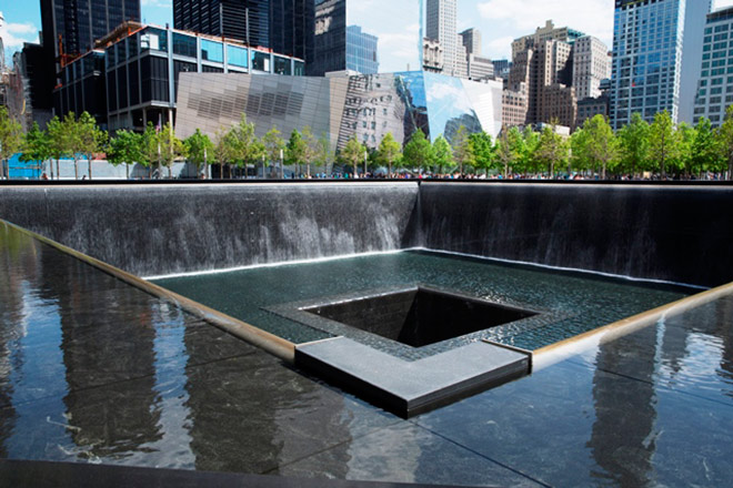 "The 9/11 Memorial Museum Pavilion is home to ""Reflecting Absence,"" which is the largest man-mad waterfall"