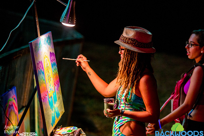 Be sure to try all the experiences at The Backwoods Music Festival including painting